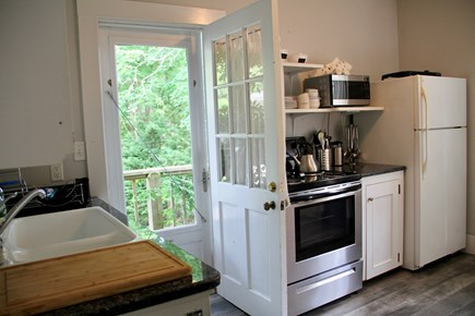 Centerville Centerville vacation rental - Kitchen door opens onto small deck .