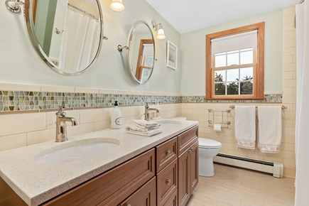 Orleans Cape Cod vacation rental - Upstairs bathroom with double sinks.