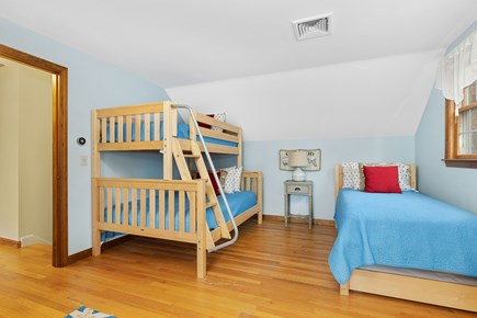 Orleans Cape Cod vacation rental - Upstairs bunk room with two twin beds and one full bed.