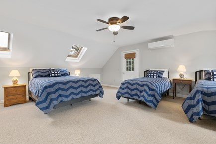 Orleans Cape Cod vacation rental - Captains quarters with queen bed, two twin beds and sofa bed.