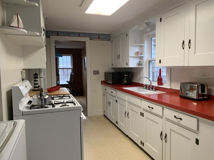 Chatham Cape Cod vacation rental - Galley Kitchen with dishwasher, microwave & gas stove/oven