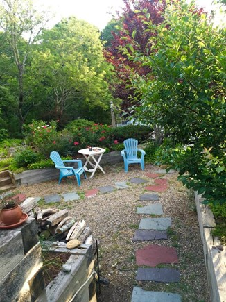 Truro Cape Cod vacation rental - Seating outside garden-level apartment
