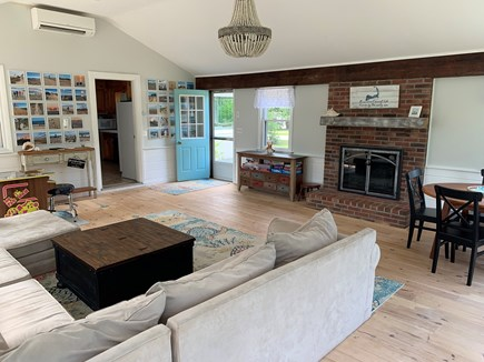 Eastham Cape Cod vacation rental - Spacious sunroom with AC, large windows, and comfortable seating