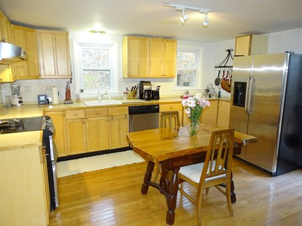 Brewster Cape Cod vacation rental - Kitchen area with stainless appliances, dining area