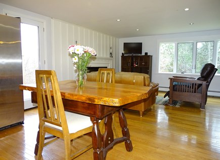 Brewster Cape Cod vacation rental - View of living room from kitchen, door to deck