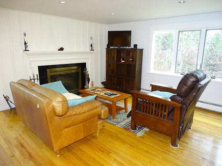 Brewster Cape Cod vacation rental - Living area with hardwood floors, fireplace, flatscreen TV