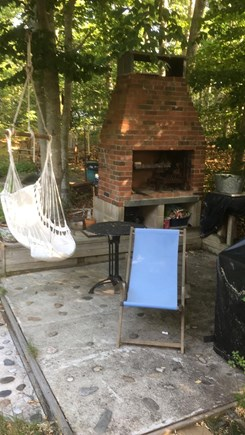 Brewster Cape Cod vacation rental - Outside patio, wood burning fireplace / bbq , gas grill & chairs