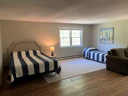 Eastham Cape Cod vacation rental - Second floor bedroom with 1 queen, 2 twins and TV area.