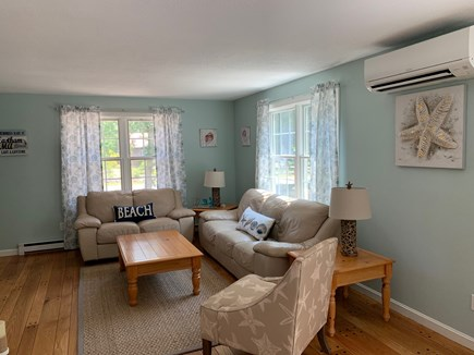 Eastham Cape Cod vacation rental - Living room area open to dining and kitchen area.