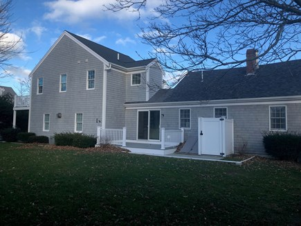Dennis Cape Cod vacation rental - Back view of the house showing private backyard