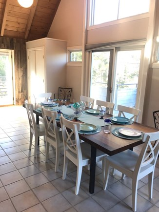 Eastham Cape Cod vacation rental - Dining open to kitchen. Sliders to deck on 3 sides.