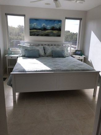 Eastham Cape Cod vacation rental - Main bedroom tile floor with a private full bathroom.