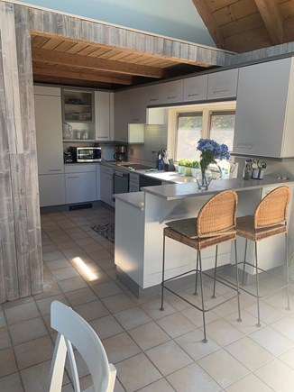 Eastham Cape Cod vacation rental - Kitchen with breakfast bar. Door to grilling & eating deck.