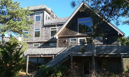 Eastham Cape Cod vacation rental - 3 sides wrap around deck off kitchen-dining with grill & table.