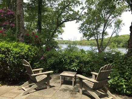 Barnstable Cape Cod vacation rental - Patio overlooking Garrett's Pond,  2 Adirondack chairs, hammock
