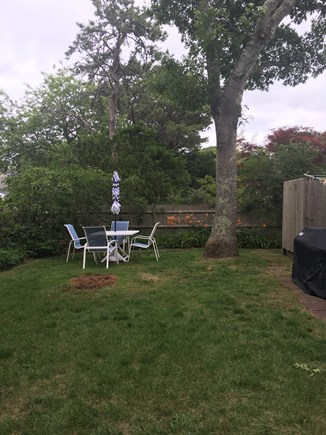 West Harwich Cape Cod vacation rental - Outdoor table, outdoor shower, and gas grill