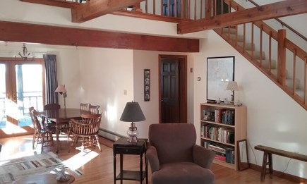 Wellfleet Cape Cod vacation rental - Living room with views, stairs to loft for sleeping & TV
