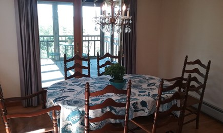 Wellfleet Cape Cod vacation rental - Dining with views that opens to screened porch & deck beyond