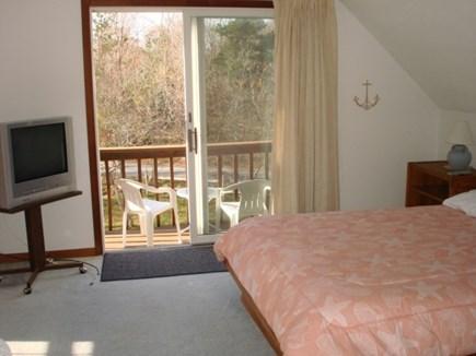 Wellfleet Cape Cod vacation rental - Main bedroom upstairs with slider to deck.