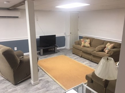 Mashpee, Popponesset Cape Cod vacation rental - TV area in finished basement with 2 couches and recliner