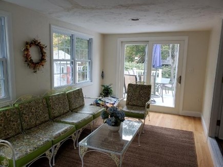 Mashpee, Popponesset Cape Cod vacation rental - 4 season sitting room with slider to large deck