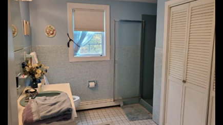 Mashpee, Popponesset Cape Cod vacation rental - Full bath with large storage closet and a washer and dryer