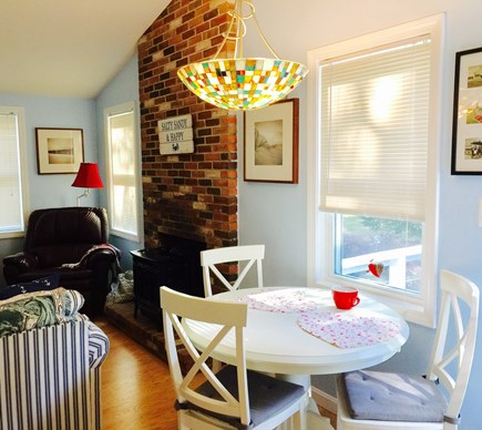 North Eastham Cape Cod vacation rental - View of gas burning stove and dining area