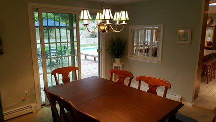 Chatham Cape Cod vacation rental - Dining area with sliders to deck and pool area