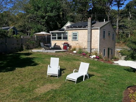 Wellfleet Cape Cod vacation rental - Back yard, flower gardens and solar panels on the roof