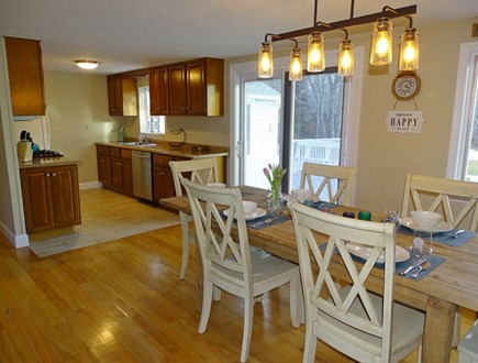 East Dennis Cape Cod vacation rental - Dining room leads to kitchen with new appliances