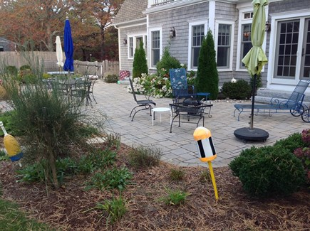 North Eastham/Bay Side Cape Cod vacation rental - Backyard west facing, gigantic patio