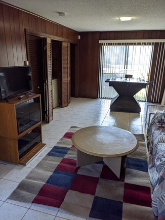East Falmouth Cape Cod vacation rental - Common area play room with couch, TV & Foosball table