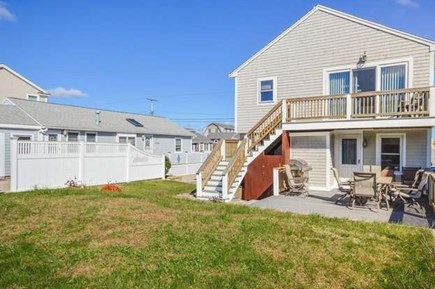 Sandwich, Sagamore Beach Cape Cod vacation rental - Back yard has grill with deck with seating and outdoor shower