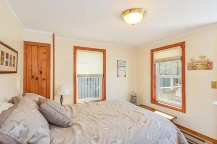 Sandwich, Sagamore Beach Cape Cod vacation rental - Downstairs bedroom w/queen bed leads to backyard deck