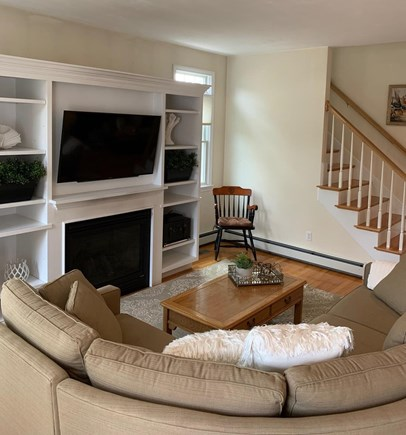 Mashpee, Popponesset Beach Cape Cod vacation rental - Comfortable living room with TV and fireplace