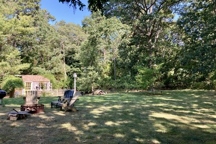 Brewster Cape Cod vacation rental - Grassy Backyard with Fire Pit