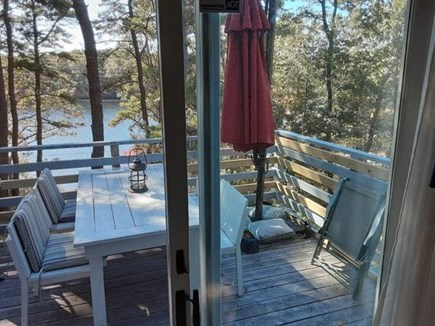 Falmouth Cape Cod vacation rental - Slider to 2 Tables on deck overlooking Pond