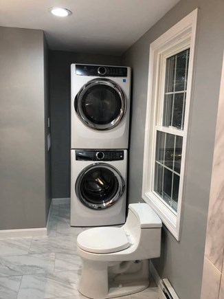 Dennisport Cape Cod vacation rental - Electroluxe washer and dryer in Master Bathroom