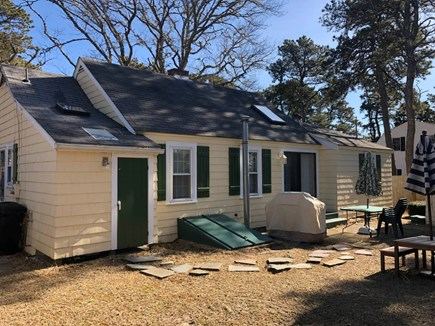 Dennisport Cape Cod vacation rental - Spacious back yard with patio and grill