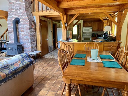 Brewster (Blueberry Pond)  Cape Cod vacation rental - Dining area looking into kitchen, big picture bay window to right