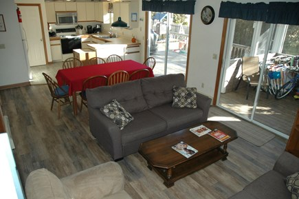 South Yarmouth Cape Cod vacation rental - Open dining & living area with access to deck & screened-in porch