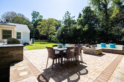 Orleans Cape Cod vacation rental - Backyard living area with grill and fire pit