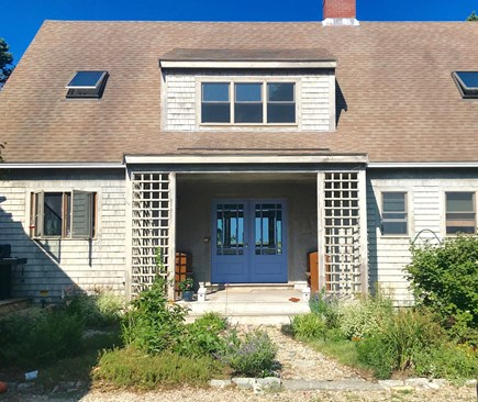 Eastham Cape Cod vacation rental - House in summer - you can see the blue of the sky and marsh views