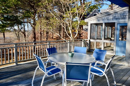 Eastham Cape Cod vacation rental - Expansive back deck with outdoor seating and screened porch