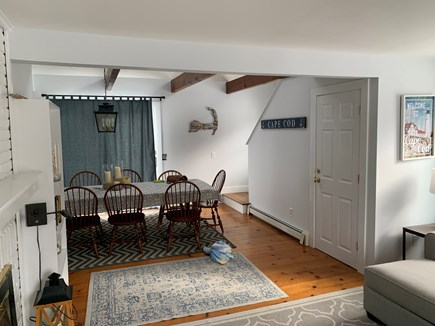 Chatham Cape Cod vacation rental - Living and dining rooms to back deck.