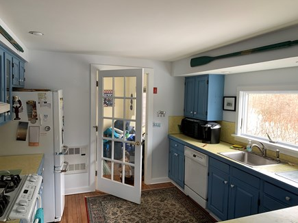 Chatham Cape Cod vacation rental - Kitchen into den.  Den has tv, trundle bed, and chairs.