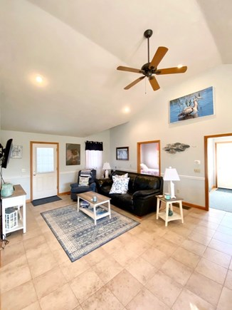 Dennis Port Cape Cod vacation rental - Living area with mounted TV door opens to outdoor shower