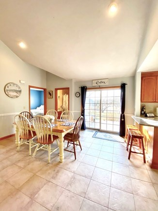 Dennis Port Cape Cod vacation rental - Large living area with lots of natural light & slider to deck