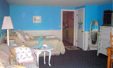 Dennis Port Cape Cod vacation rental - Sleeping area with kitchen beyond