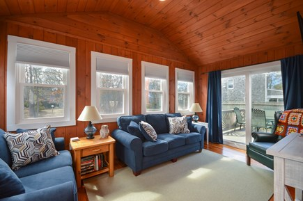 Falmouth Cape Cod vacation rental - Lots of bright light in the living room looking out to the deck